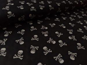 Baumwollstoff, Totenkopf Motiv / Piratenmotiv auf Schwarz, Restposten zum Sonderpreis 0,42 Meter